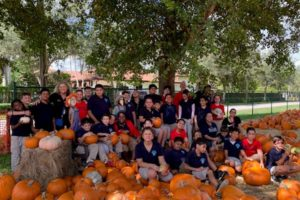 Class photo of group of students at a pumpkin patch
